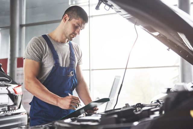 Portrait Of A Mechanic At Work In His Garage - Car Service, Repa